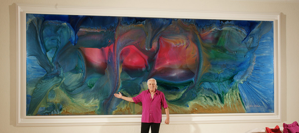 Picture of Elan Vital next to monumental painting in Palm Desert